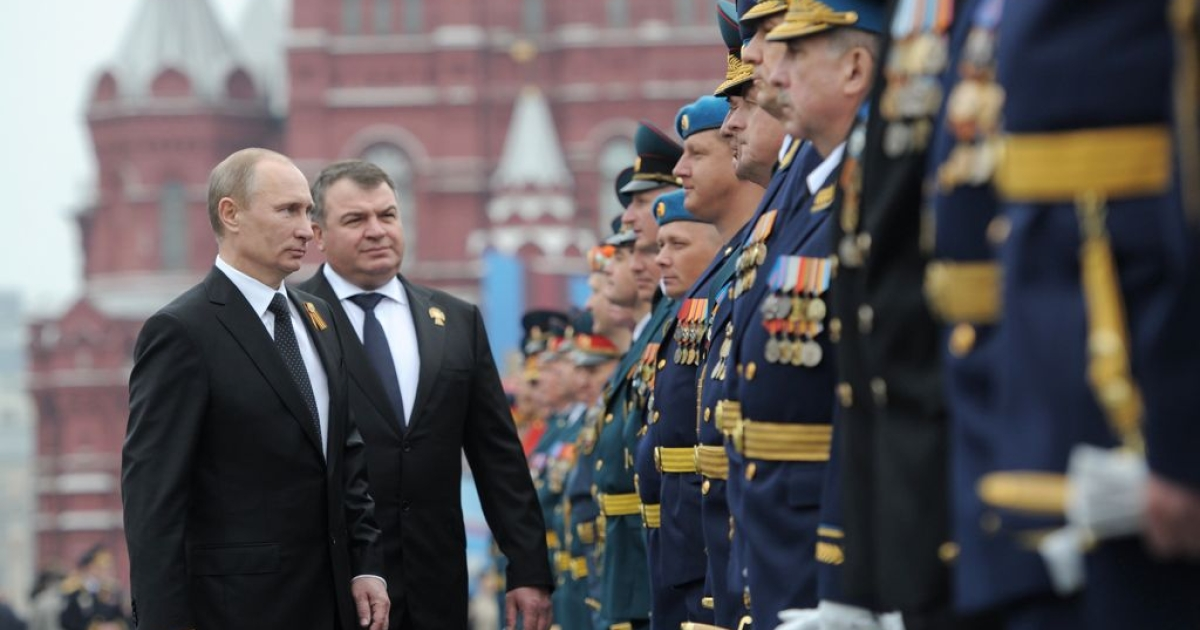 President Vladimir Putin and then Defense Minister Anatoly Serdyukov inspect the troops in Moscow in May 2012. Putin has fired Serdyukov over a corruption scandal at the Defense Ministry.</p>