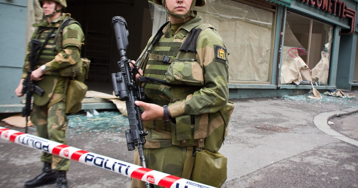 Soldiers block a street in the government headquarters building area in central Oslo on July 23, 2011, a day after twin attacks here and on a youth camp, Norway's deadliest post-war tragedy.</p>