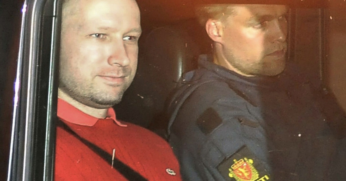 Bomb and terror suspect Anders Behring Breivik (red top) leaves the courthouse in a police car in Oslo on July 25, 2011, after the hearing to decide his further detention. Breivik will be held in solitary confinement for the first four weeks, with a ban on all communication with the outside world in a bid to aid a police investigation into his acts.</p>