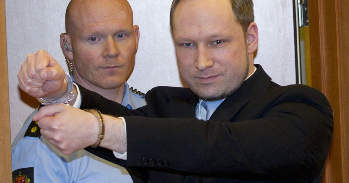 Norwegian right-wing extremist Anders Behring Breivik (R), 32, arrives on February 6, 2012 in court in Oslo that was convened for a hearing on his detention. The Norway gunman who killed 77 people in twin attacks on July 22, 2011 asked an Oslo court to release him immediately, explaining that his massacre was a