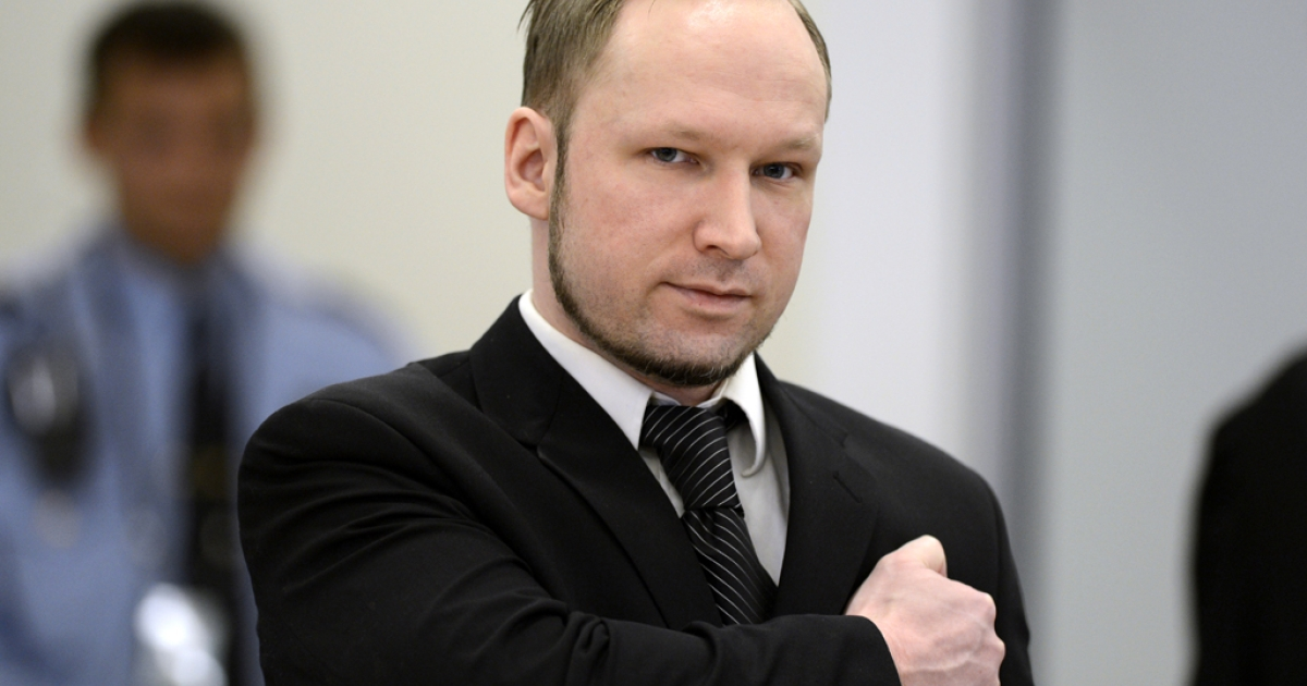 Self confessed mass murderer and right-wing extremist Anders Behring Breivik places a clenched fist on his heart in a salute as he arrive on day three in room 250 at the central court in Oslo on April 18, 2012. Anders Behring Breivik, who killed 77 people in Norway last July, took the stand again on April 19, 2012, stating that he originally planned to detonate three bombs.</p>