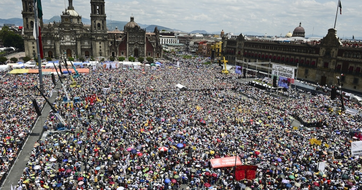 Thousands of supporters of leftist politician Andres Manuel Lopez Obrador attend a rally in Mexico City's Zocalo Square today.</p>