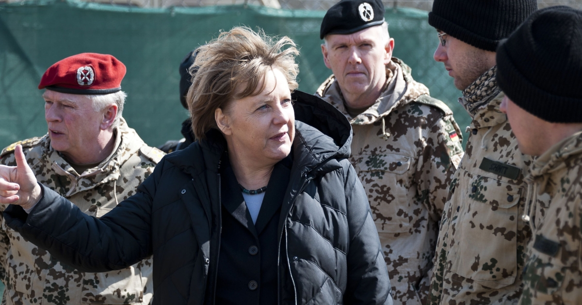 German Chancellor Angela Merkel pays a visit to Northern Afghanistan in the spring of 2012. Germany announced its willingness to keep up to 800 troops in Afghanistan on a training mission after the combat pullout on April 18th, 2013.</p>