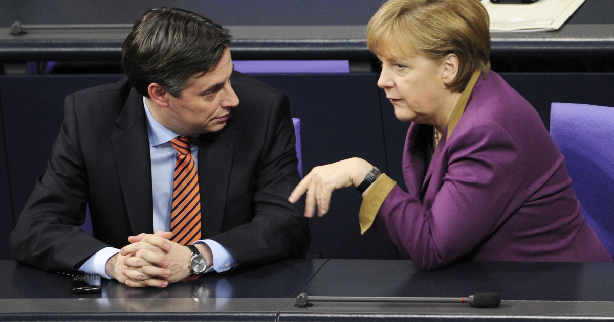 German Chancellor Angela Merkel (R) speaks with Lower Saxony's State Premier David McAllister at a session at a meeting of Germany's lower house of parliament on February 27, 2012 in Berlin.</p>