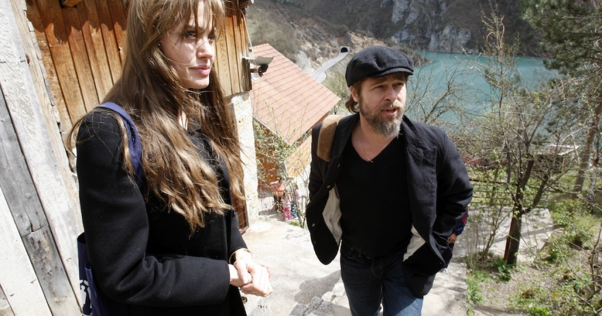 Angelina Jolie and Brad Pitt visit refugees in the village of Medjedja, near the eastern Bosnian town of Visegrad, 70 kilometers (43 miles) east of Sarajevo on April 5, 2010 on a surprise visit to meet refugees still suffering from the brutal 1992-1995 civil war.</p>