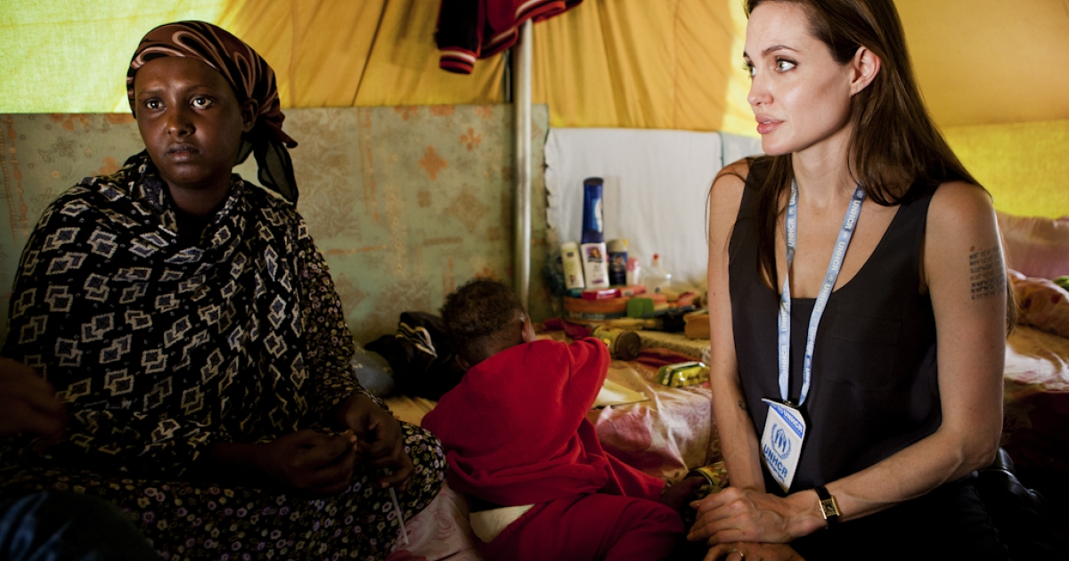 Angelina Jolie, a goodwill ambassador for the UN refugee agency, visits refugees at a camp near the Tunisia-Libya border in April. The actress visited Libya on October 11, 2011 in a
