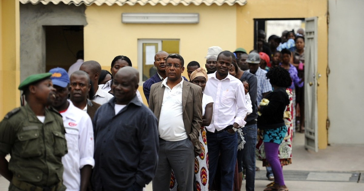 Angolans line up to vote on August 31, 2012 at a polling station in the outskirts of Luanda. The ruling Popular Movement for the Liberation of Angola party (MPLA) of President Jose Eduardo dos Santos, which has been in power since independence 37 years ago, competed in the legislative poll against 8 other political parties, including the main opposition Union for the Total Independence of Angola (UNITA). Dos Santos promised that with a new term he would push ahead with his multi-billion-dollar drive to rebuild the country after the civil war that ended a decade ago. MPLA was widely expecting to win the elections and beat the UNITA former rebel movement, which does not have the same access to funds or the state-controlled media.</p>