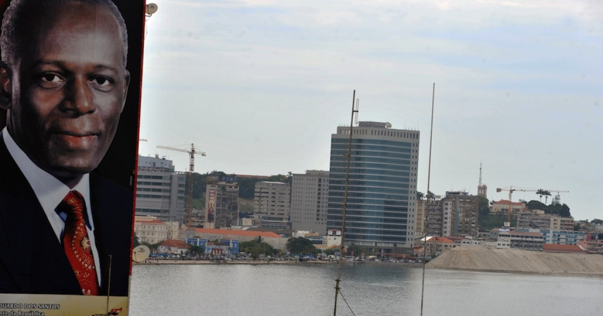 A giant portrait of Angolan President Jose Eduardo Dos Santos is seen in the center of Luanda on January 30, 2010. The Angolan capital is undergoing since 2002 a massive reconstruction following 27 years of civil war.</p>