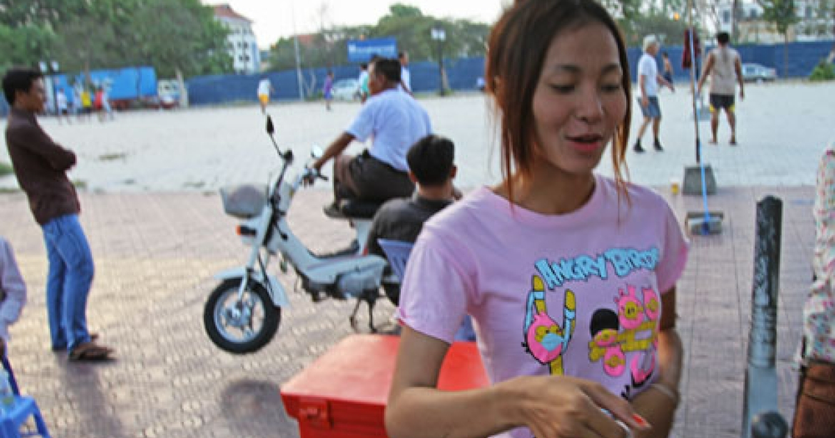 A Phnom Penh snack vendor sporting an Angry Birds T-shirt. In rural and urban Cambodia alike, Angry Birds fashion is a runaway hit.</p>