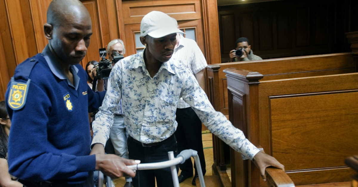 Xolile Mngeni, the man accused of killing Swedish honeymooner Anni Dewani, walks with a Zimer frame as he arrives into the Cape Town's High Court on November 19, 2012, to hear judgment. Mngeni has suffered from a brain tumor, which was removed before the case started. Mngeni claimed innocence in the November 2010 killing but admitted to his palm print having been found on the car in which Dewani's lifeless body was found in a poor Cape Town township. State prosecutor told Mngeni that his claims of not being at the murder scene were lies, as witnesses had testified otherwise and claimed that he had pulled the trigger. The 25-year-old had also been found in possession of items taken from Dewani and the honeymooning couple's taxi driver and had pointed out key details of the slaying to police after his arrest, prosecutor said.</p>