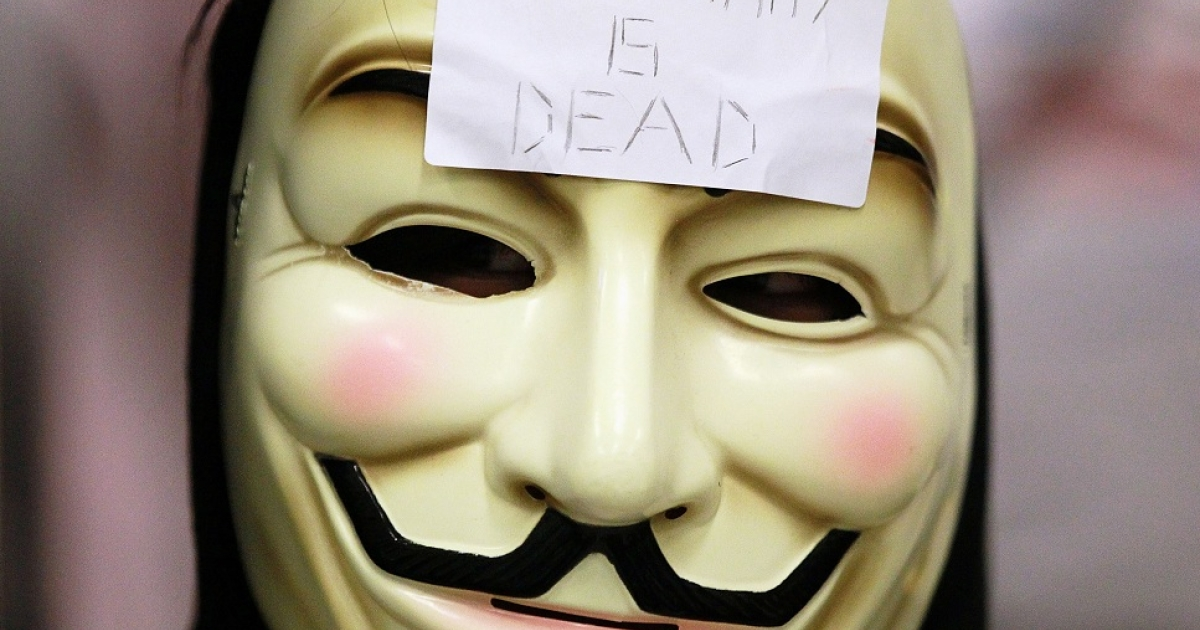 SAN FRANCISCO, CA - AUGUST 15:  A demonstrator wears a mask during a protest inside the Bay Area Rapid Transit (BART) Civic Center station on August 15, 2011 in San Francisco, California.  The hacker group