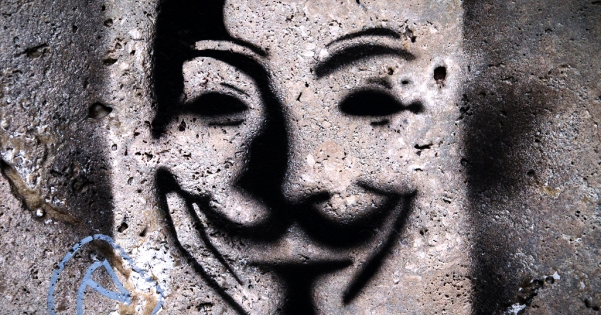 Picture of a painting on a wall representing Anonymous Guy Fawkes mask taken in a street of Paris, on April 24, 2012.</p>
