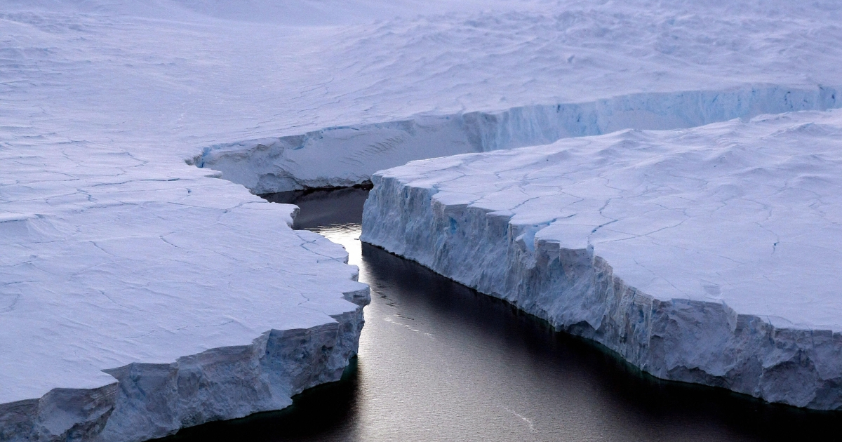 An enormous iceberg (R) breaks off the Knox Coast in the Australian Antarctic Territory on January 11, 2008.</p>