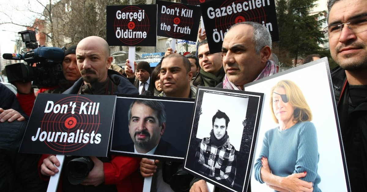 Turkish journalists in Ankara, on February 24, 2012, hold pictures of journalists who died covering the crisis in Syria, New York Times correspondent Anthony Shadid (L), who died from an asthma attack as he was crossing from Syria back to Turkey, and French photojournalist Remi Ochlik (C) and Sunday Times correspondent Marie Colvin (R), killed in an alleged rocket attack by Syrian regime forces against a makeshift opposition media center in the besieged city of Homs in Syria on February 22, during a demonstration by journalists denouncing violence against members of the media and the brutality of Syrian President Bashar al-Assad's regime.</p>