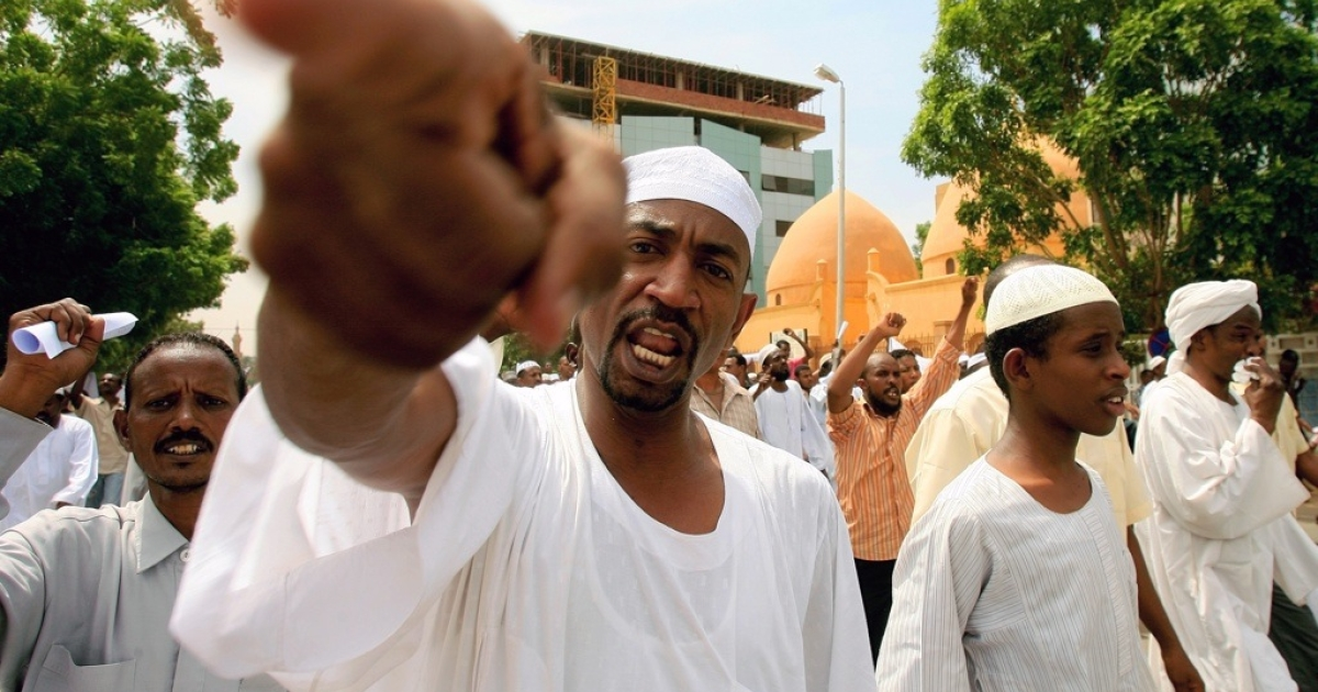 Sudanese men shout slogans during a protest in Khartoum on Sept. 14, 2012.</p>