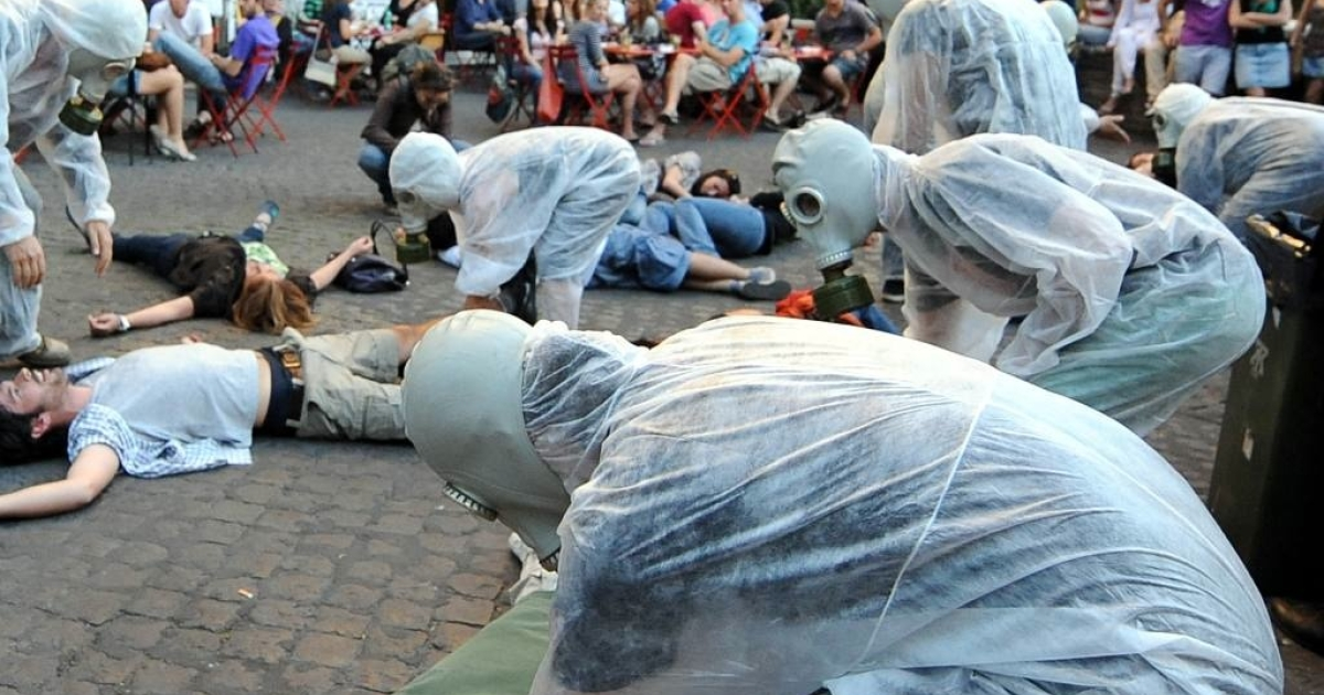 Activists simulate a massive death during a flash mob to protest against nuclear technology on Politeama Square in central Rome on May 29, 2011.</p>