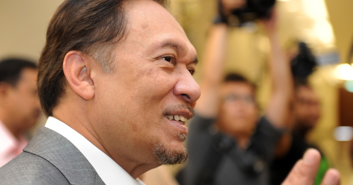 Malaysian opposition leader Anwar Ibrahim arrives at court in Kuala Lumpur on Aug. 8, 2011.</p>