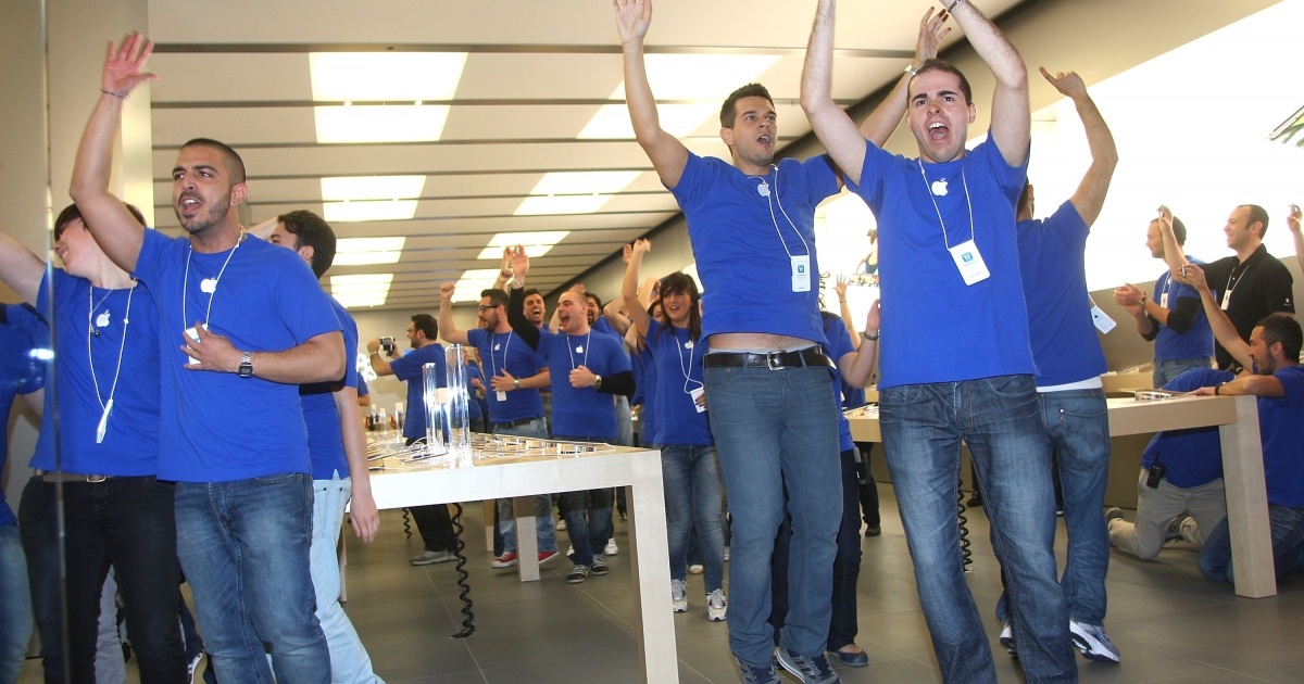 Apple Store employees cheer during the grand opening of the Apple Store Porta di Roma on April 21 in Rome.</p>