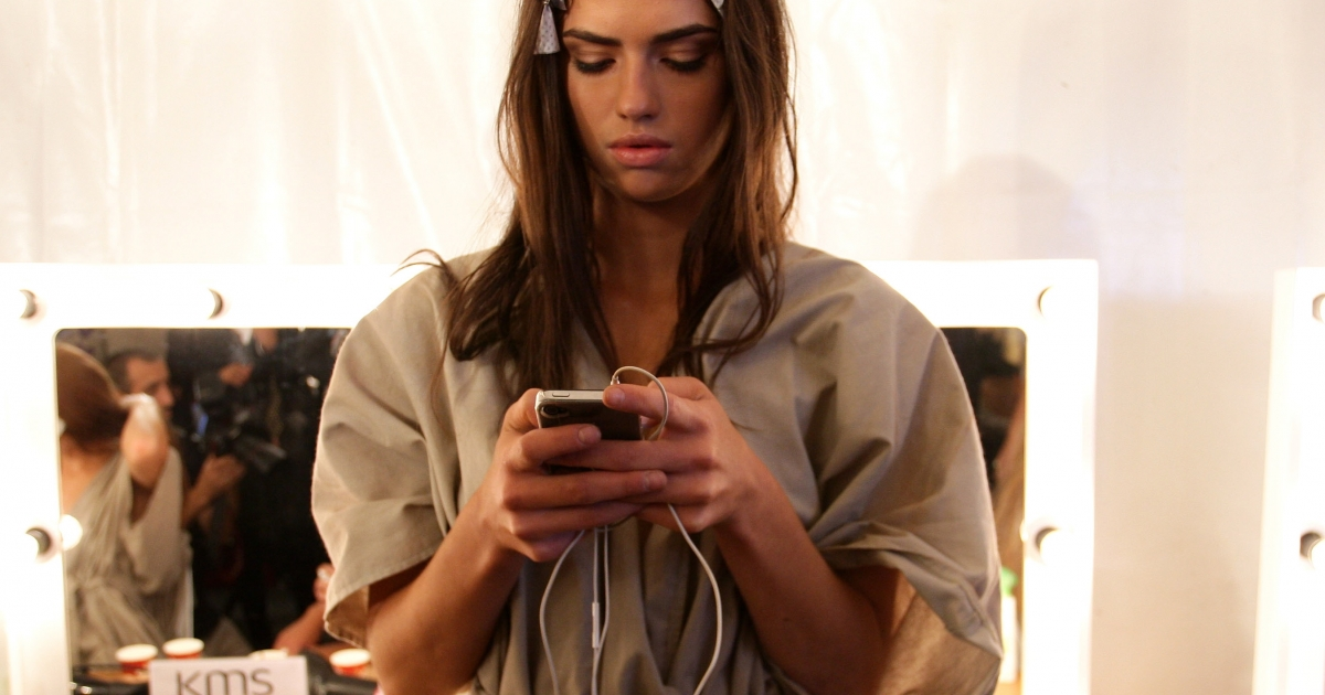 A model uses her Apple device backstage ahead of the Nookie Beach show during Rosemount Australian Fashion Week at the Overseas Passenger Terminal in Sydney, Australia on May 3, 2011.</p>
