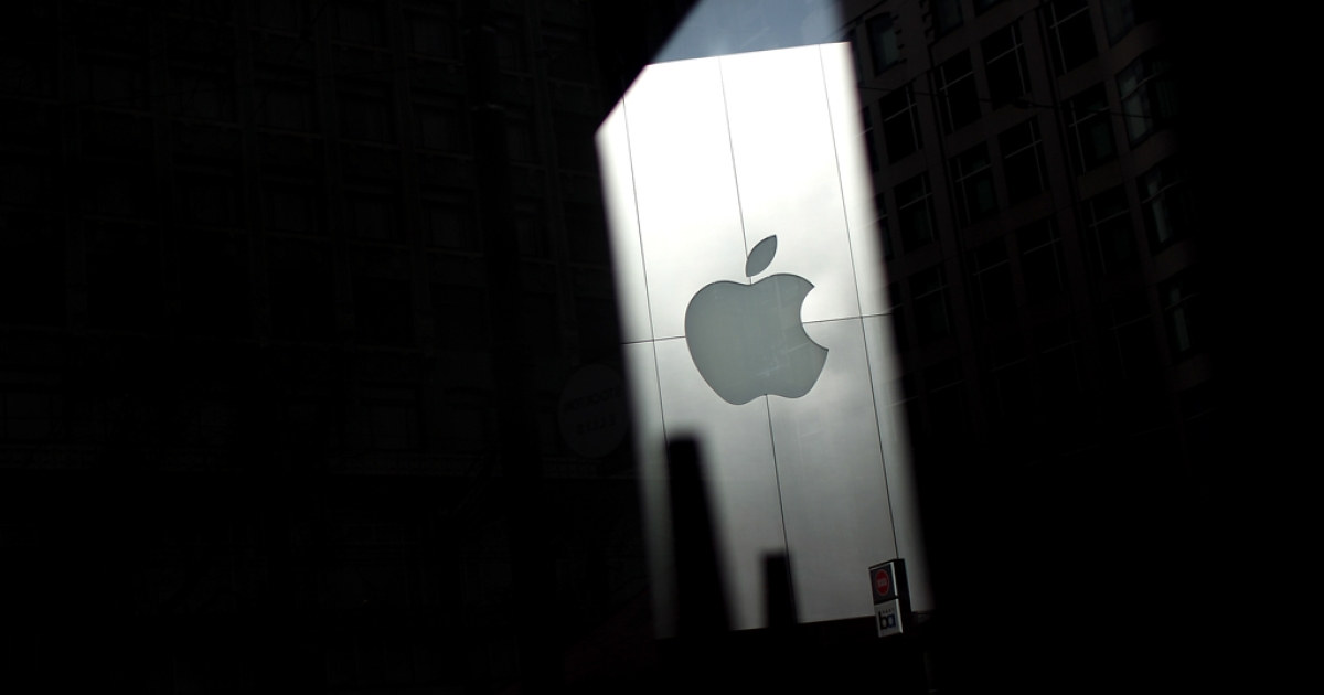 The Apple logo on an Apple Store is seen through a window. The company's stock reached $600 today, a day before the new iPad release.</p>