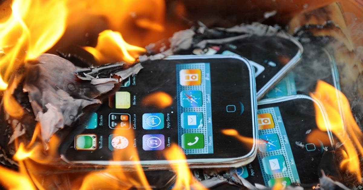 Protestors from SACOM (Students and Scholars Against Corporate Misbehaviour) burn effigies of Apple products during a demonstration near the offices of Foxconn in Hong Kong on May 25, 2010. Harsh working conditions and child labor where its product are made put Apple under fire earlier this year.</p>