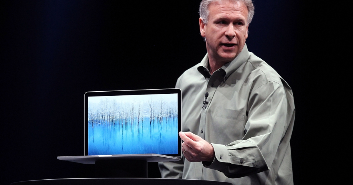 Apple Senior Vice President of Worldwide product marketing Phil Schiller announces the new MacBook Pro during the keynote address during the Apple 2012 World Wide Developers Conference (WWDC) at Moscone West on June 11, 2012 in San Francisco, California. According to reports Apple is expected to unveil a slew of new hardware and software updates at the company's annual developer conference which runs through June 15.</p>