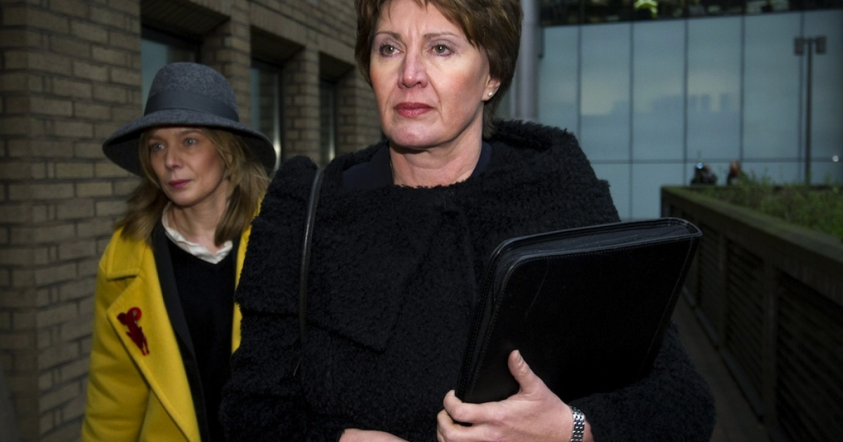 In this file picture taken on January 7, 2013 Detective April Casburn arrives at Southwark Crown Court in central London, to face charges related to misconduct in a public office over claims she passed information to the News of the World, the now-defunct tabloid. A former British counter-terrorism detective was found guilty on January 10, 2013 of trying to sell information about a phone hacking investigation to the Rupert Murdoch-owned News of the World tabloid. A jury convicted Detective Chief Inspector April Casburn of offering the now-defunct newspaper information about a probe into whether Scotland Yard's inquiry into the illegal hacking of mobile phones should be reopened.</p>