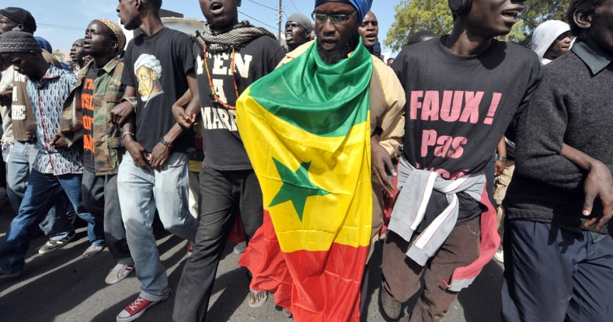 People demonstrate during a protest organized by the June 23 Movement (M23) which opposes Senegal's President Abdoulaye Wade's candidacy on Jan. 27, 2012 in Dakar.</p>