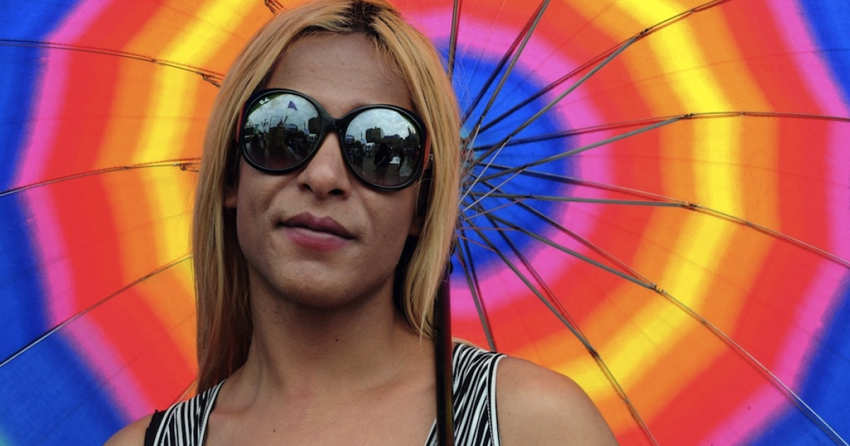 A transsexual waits outside the Congress while the Senate debates the bill of gender identity in Buenos Aires, on May 9, 2012. The law took effect Monday.</p>