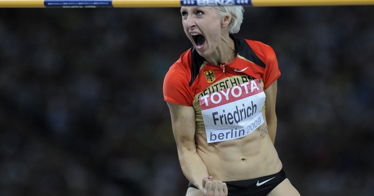 Germany's Ariane Friedrich celebrates after taking the third place in the women's high jump final of the 2009 IAAF Athletics World Championships on August 20, 2009 in Berlin.</p>