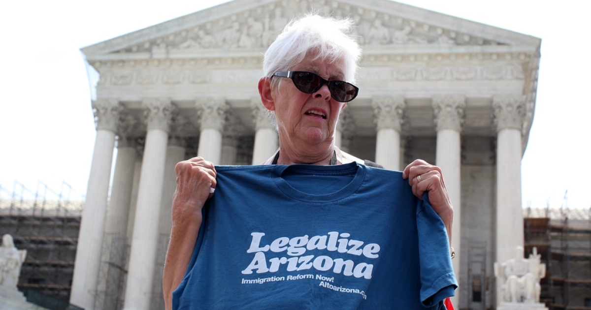 Jane Pauk, of Phoenix, Ariz., pushed for support of her state's controversial immigration reform in front of the US Supreme Court.</p>