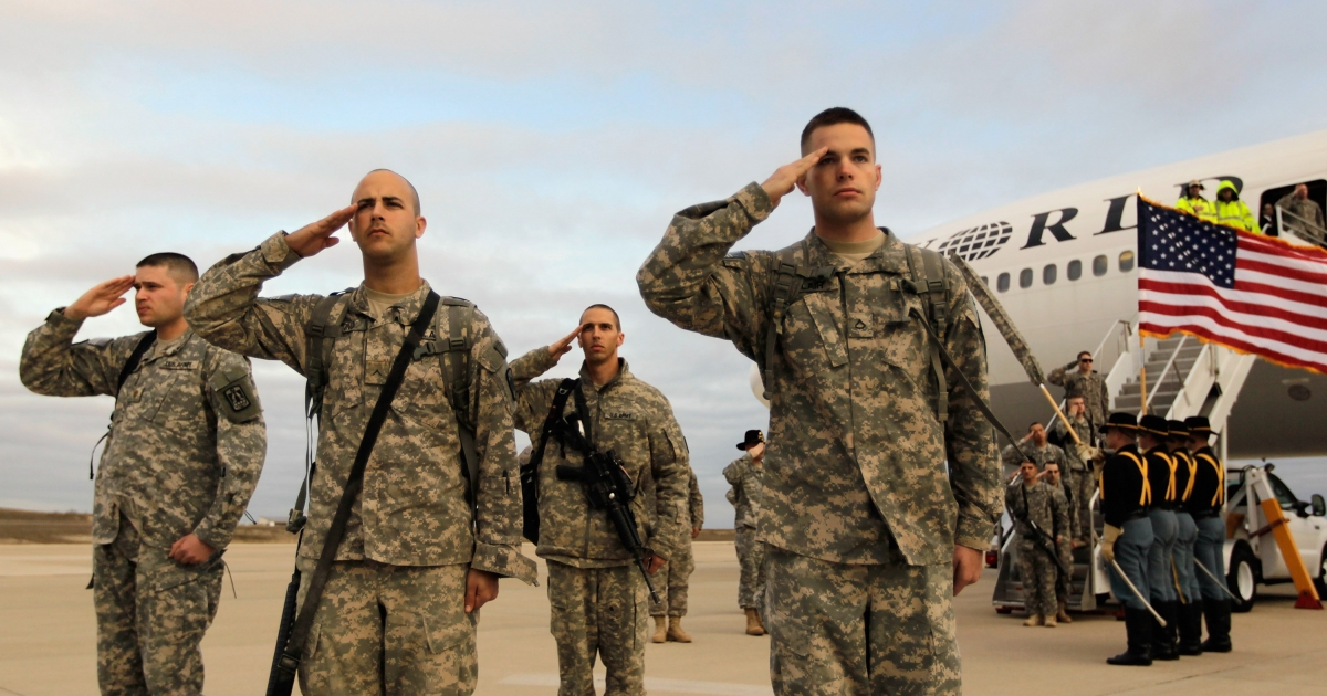 U.S. Army soldiers from the 3rd Brigade, 1st Cavalry Division salute on Dec 16 as they arrive at their home base,  Fort Hood, Texas after being part of one of the last American combat units to exit from Iraq.</p>