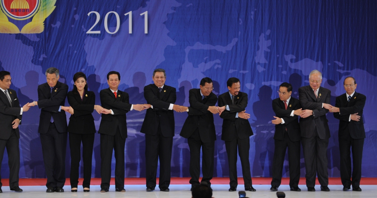 The leaders and representatives of the Association of South East Asian Nations (ASEAN) link hands for a group photograph during the opening of the 19th ASEAN Summit in Nusa Dua at Indonesia's resort island of Bali on November 17, 2011. From left Philippine Senior Official Ricky Carandang, Singapore Prime Minister Lee Hsien Loong, Thai Prime Minister Yingluck Shinawatra, Vietnam Prime Minister Nguyen Tan Dung, Indonesian President Susilo Bambang Yudhoyono, Cambodian Prime Minister Hun Sen, Brunei Sultan Hassanal Bolkiah, Laos Prime Minister Thongsing Thammavong, Malaysian Prime Minister Najib Razak and Myanmar President Thein Sein.</p>