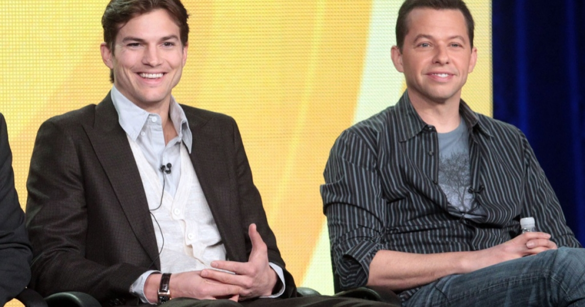 Actors Ashton Kutcher (L) and Jon Cryer of the television show