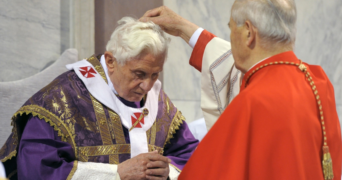 Pope Benedict XVI, left, receives ashes during mass in Rome's Santa Sabina church today, Ash Wednesday. The ceremony opens Lent, the 40-day period of abstinence and sacrifice for the Christians leading up to Easter.</p>