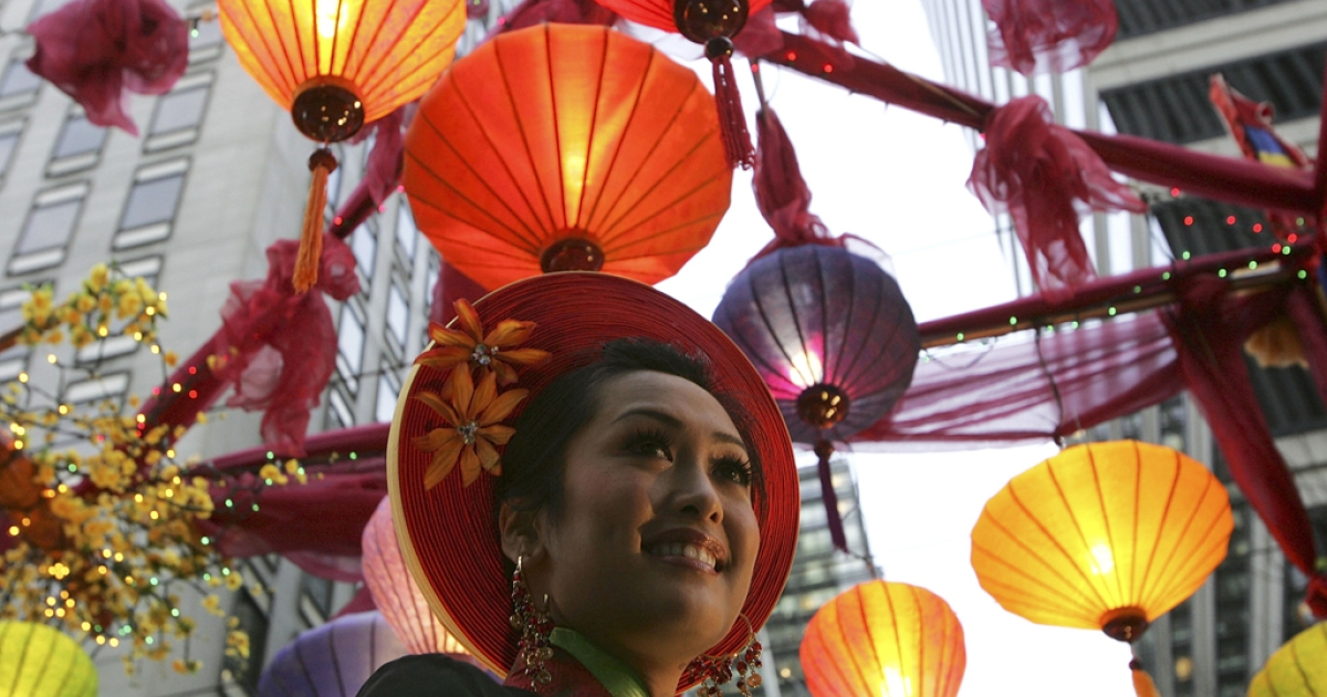 A woman rides a float during Chinese New Year Festival in San Francisco, California. A report released by the Pew Research Center on June 19, 2012 found that Asians have surpassed Hispanics as the largest wave of immigrants to America in the last few years.</p>