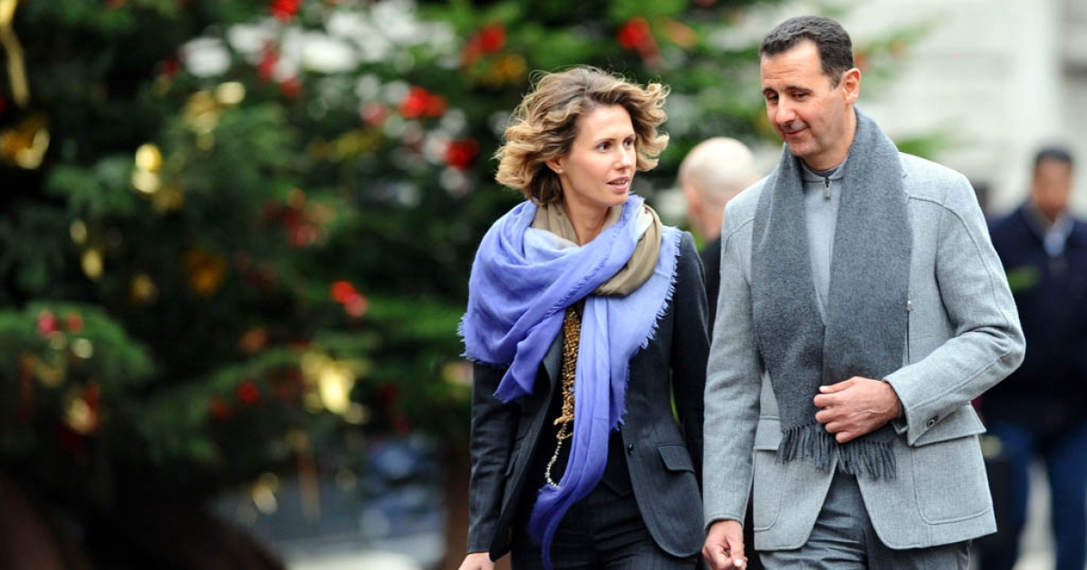 Syrian president Bashar al-Assad and his wife, Asma, walk in Paris during an official visit to France in 2010. Would have made a great shot for his new Instagram account.</p>