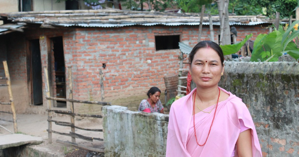 Asmani Chaudary stands outside her office, in the Tharu community where she was raised.  The Tharus are a marginalized population in the Terai region of Nepal.</p>