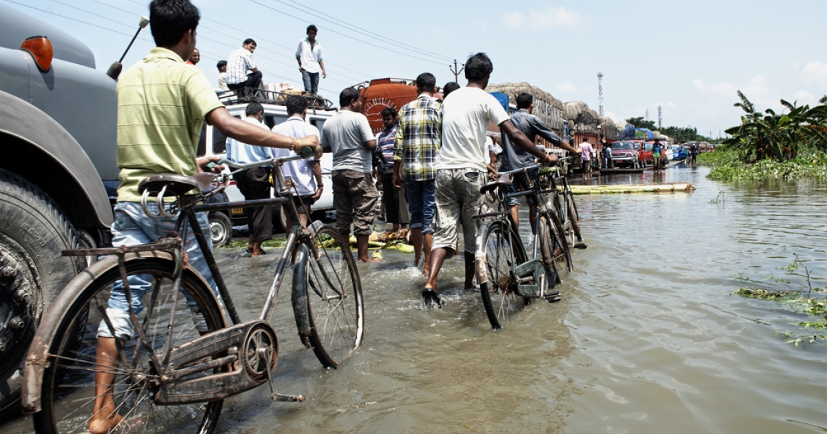 This picture was taken on June 29, 2012 on national highway 31 at Chepte in Kamrup district, Assam. At least 77 people have been killed and nearly two million fled their homes as heavy monsoons caused floods in Assam, India.</p>