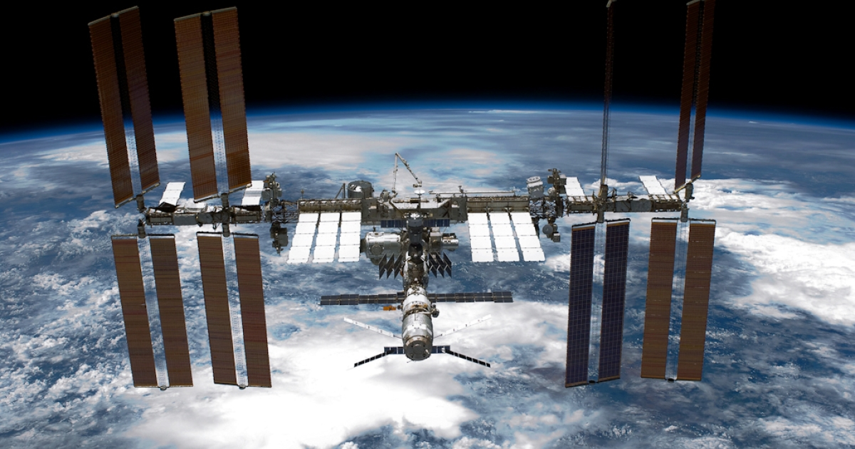 With planet Earth as a backdrop, the International Space Station (ISS) is seen from NASA space shuttle Endeavour after the station and shuttle began their post-undocking relative separation May 29, 2011 in space.</p>