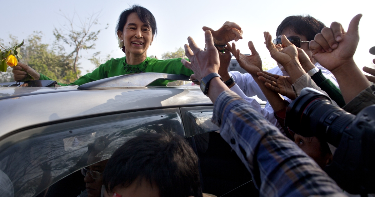 Burma opposition leader Aung San Suu Kyi greets the crowds from a vehicle during campaigning in the Delta region on her second campaign trip on Feb. 7, 2012 in Pathein.</p>