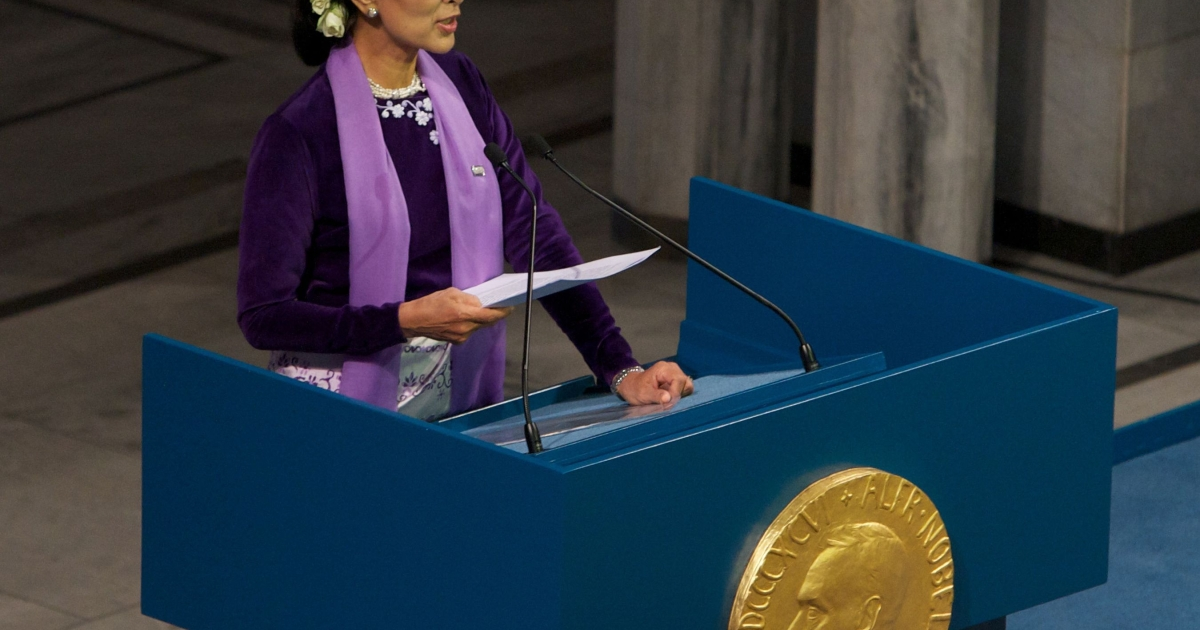 Nobel Laureate Aung San Suu Kyi delivers her acceptance speech at Oslo City Hall on June 16, 2012 in Norway.</p>
