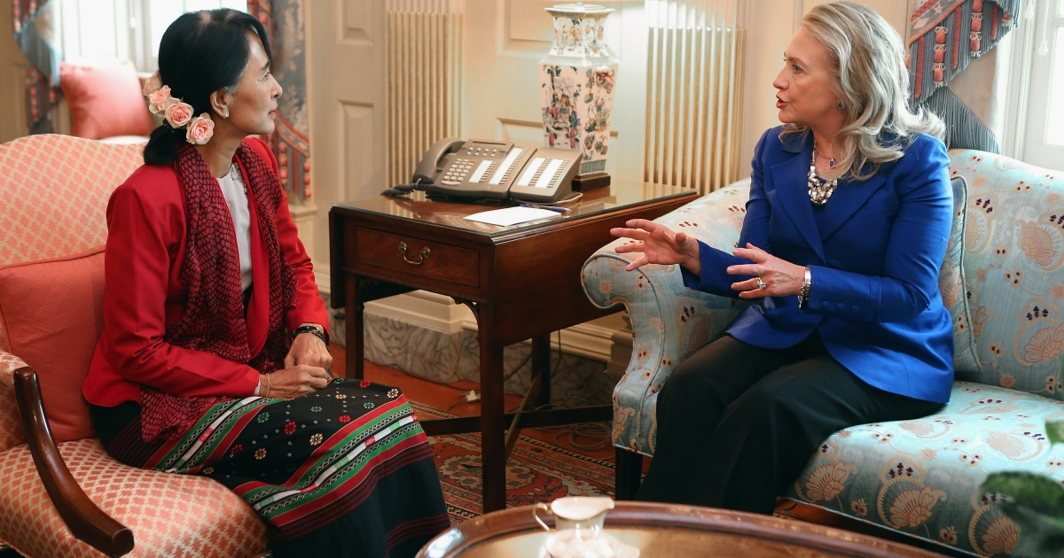 US Secretary of State Hillary Clinton meets with Nobel Peace Prize winner and Myanmar pro-democracy opposition leader Aung San Suu Kyi in Clinton's office at the State Department, Sept. 18, 2012 in Washington, DC. Having spend most of the last two decades as a political prisoner under house arrest in her home nation of Myanmar, formerly known as Burma, Suu Kyi was elected to parliament in 2012 and her political party, the National League for Democracy, won a majority of seats.</p>