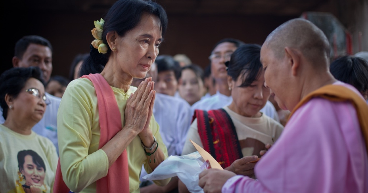 Democracy icon Aung San Suu Kyi hands out donations to Buddhist monks at the National League for Democracy (NLD) headquarters in Rangoon on Dec. 8, 2010. Over a thousand Buddhist monks and nuns gathered to receive a yearly donation from the NLD.</p>