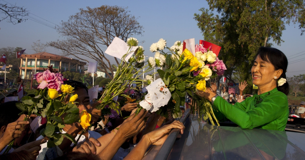 Myanmar opposition leader Aung San Suu Kyi receives flowers from the crowds during campaigning in the Delta region on her second campaign trip on February 7, 2012 in Pathein, Myanmar.  Aung San Suu Kyi's party, the National League for Democracy, complained about restrictions on rallies and the election authorities responded quickly by lifting the bans.</p>