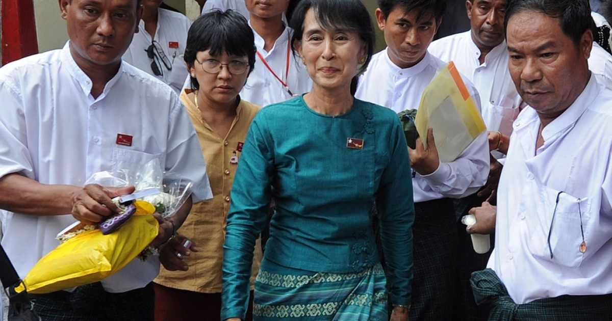 Myanmar opposition leader Aung San Suu Kyi (C) walks out of her National League for Democracy (NLD) headquarters after attending a meeting of the NLD campaign committee with newly-elected NLD candidates in the April 1 by-elections in Yangon on April 7, 2012.  Suu Kyi's party won almost all the seats it contested in Myanmar elections, becoming the main opposition force in the national parliament, official results showed.</p>
