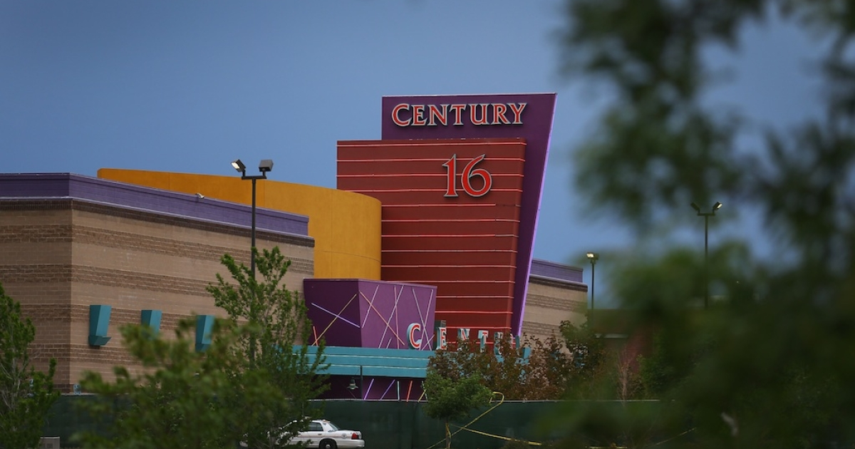 The Century 16 movie theatre is seen from a memorial setup across the street on July 28, 2012 in Aurora, Colorado.</p>