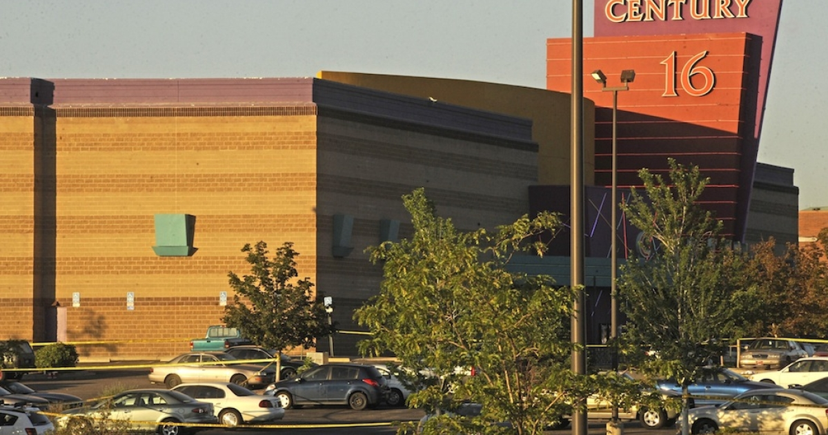 The Century 16 Theatre where a masked gunman killed 14 people at a midnight showing of the new Batman movie in Aurora, Colorado July 20, 2012. A masked gunman killed 14 people at a midnight showing of the new Batman movie in a suburb of Denver early on Friday, sparking pandemonium when he hurled a teargas canister into the auditorium and opened fire on moviegoers.</p>