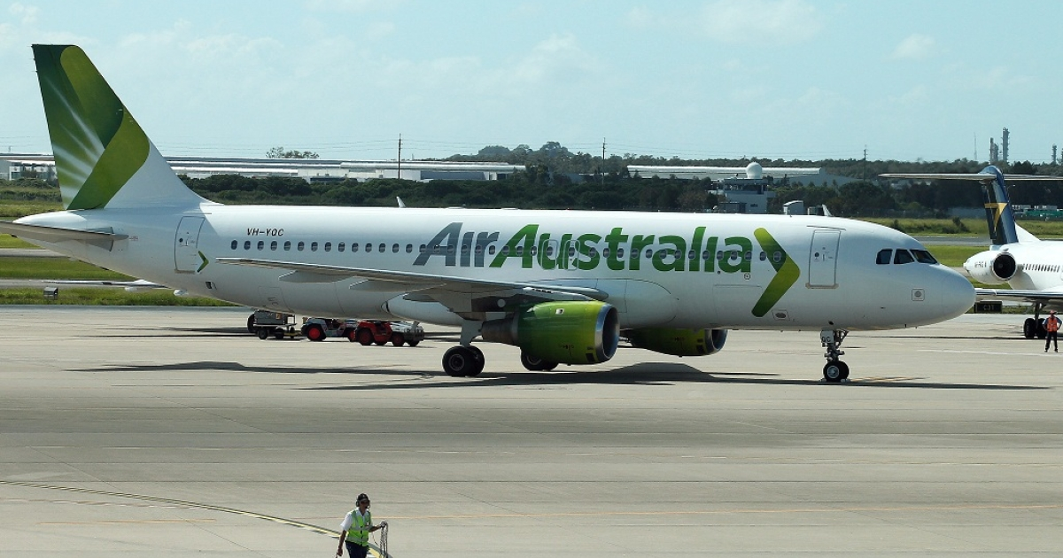 A grounded Air Australia plane sits unattended on the tarmac of the Brisbane International airport in Brisbane on Feb. 17, after being placed into administration. Now the airline's owners are auctioning what few assets they had to help pay off their debts.</p>