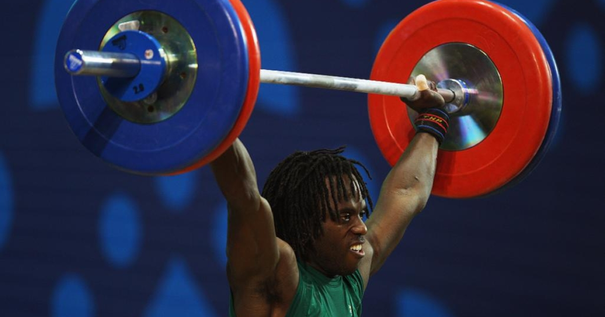 Daniel Koum of Australia competes in the men's 62kg weightlifting group at the 2010 Commonwealth Games in New Delhi, India.</p>